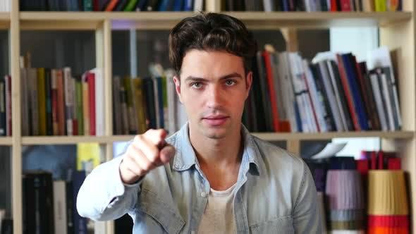 Thumbnail for Young Man Pointing at Camera, Gesture