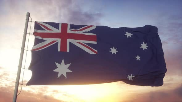 Australia Flag Waving in the Wind Against Deep Beautiful Sky