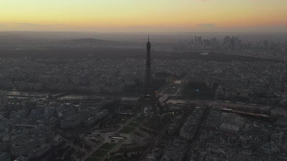 Cover Image for AERIAL: Reverse Drone Flight From Eiffel Tower, Tour Eiffel in Paris, France with View on Seine
