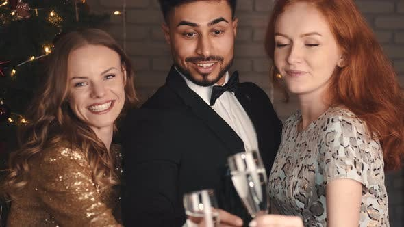 Thumbnail for Mixed Race Friends Clinking at Holiday Party in New Year