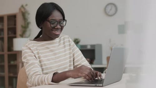 Female Freelancer Having Video Meeting with Colleague