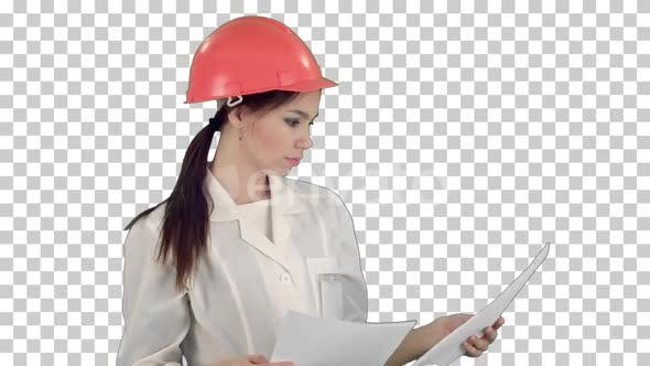 Thumbnail for Female engineer in helmet reading contract, Alpha Channel