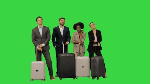 A Group of Business People with Suitcases Waiting for Something Looking Tired on a Green Screen