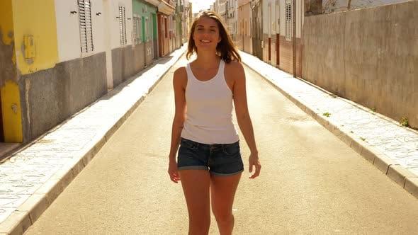 Thumbnail for Slim Model Walking Towards Camera in Empty Street