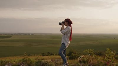 Girl Start to Take Some Photos on a Fields