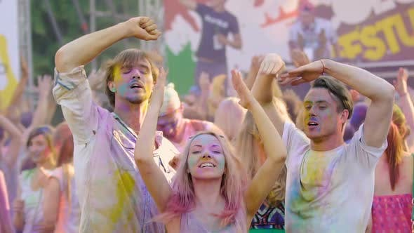 Thumbnail for Young Smiling People Covered in Colorful Powder Dancing at Holi Festival Concert