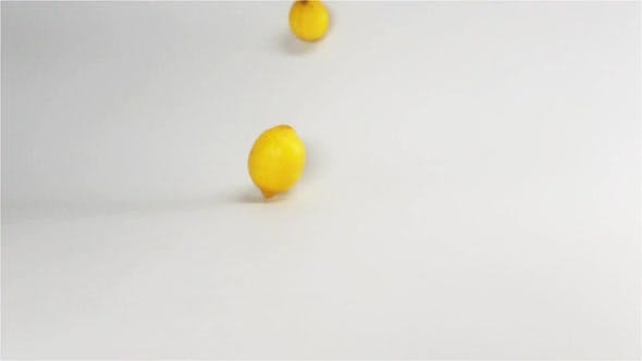 Thumbnail for Fresh Yellow Lemons Falling Down on White Surface