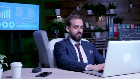 Businessman Working Long After the Office Closing Hours