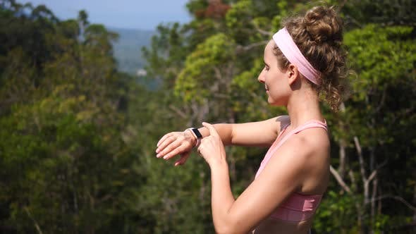 Sport Hiker Woman Using Smartwatch While Hiking In Forest