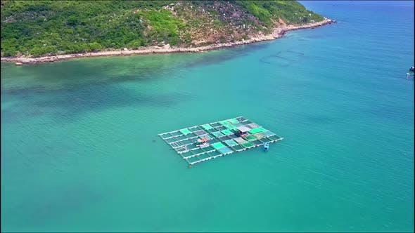 Thumbnail for Drone Approaches Floating on Sea Lobster Farm By Coast
