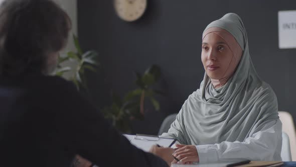 Thumbnail for Muslim Woman in Hijab Having Job Interview with HR Manager