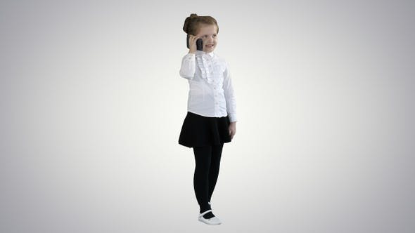 Thumbnail for Beautiful little girl, talking on the phone on gradient background.
