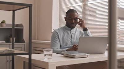 African Man Tired of Job Responsibilities