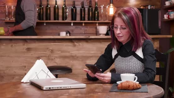 Thumbnail for Mature Businesswoman Texting on Her Phone