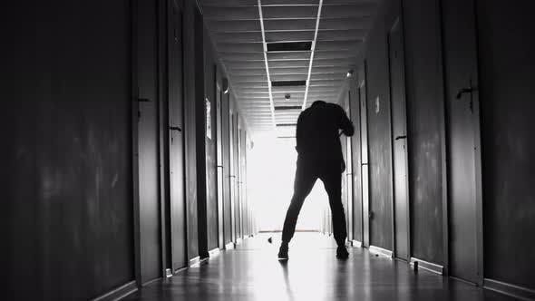 Thumbnail for Janitor Sweeping Floor in Dark Hallway