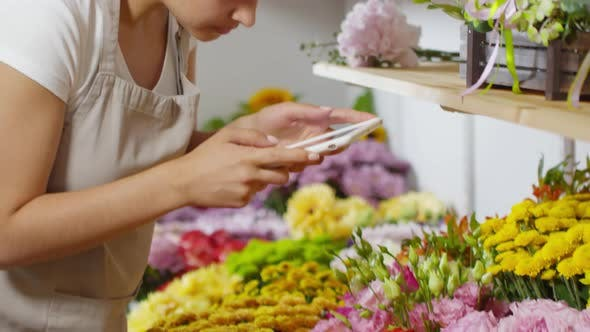 Thumbnail for Young Florist Taking Photos of Flowers