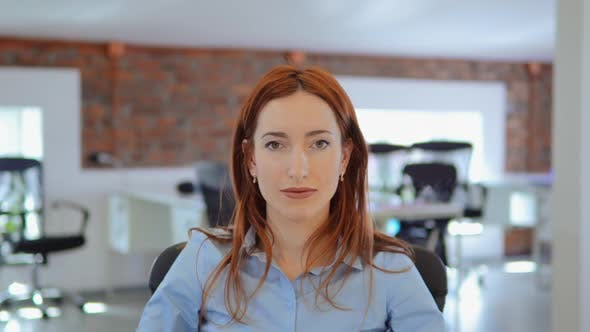 Thumbnail for Redhead Businesswoman Celebrating Great News at Work