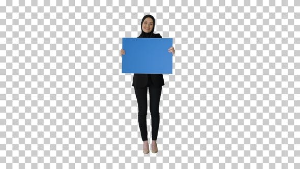 Smiling Arab woman in hijab holding blank, Alpha Channel
