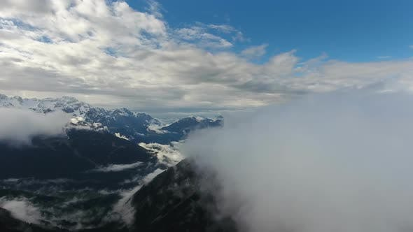 Thumbnail for Flying Through Clouds Between Mountains