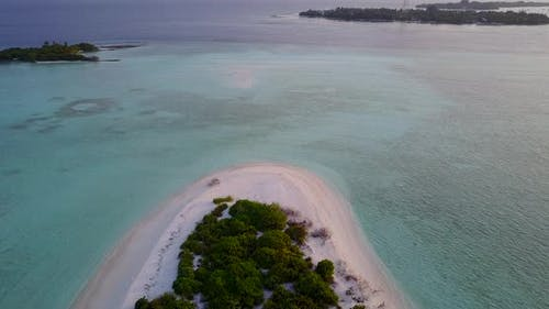 Beautiful overhead tourism shot of a sunshine white sandy paradise beach and blue water background