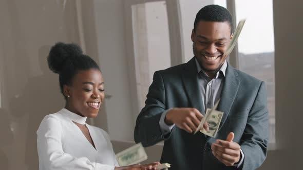 Ethnic Business Couple Celebrating Success