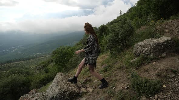 Thumbnail for A Girl Looks at the Magnificent Landscape of Nature From the Edge of the Cliff