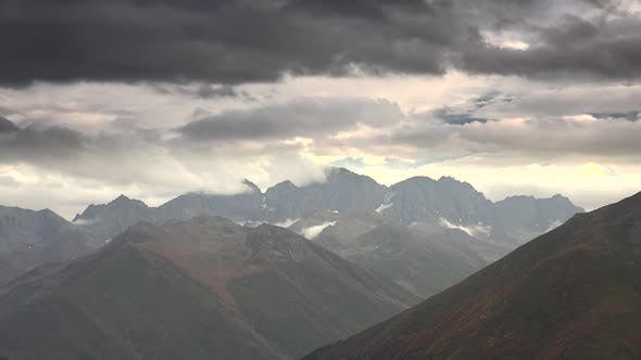 Thumbnail for Clouds Passing Over Barren Rocky Mountain Summit