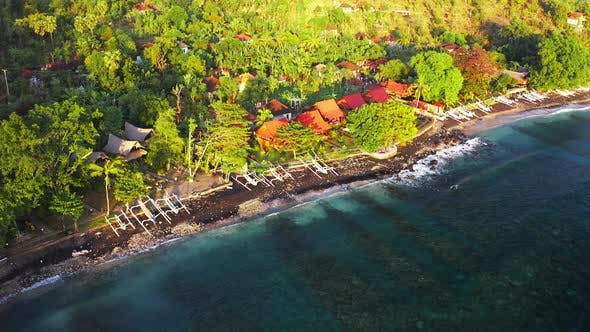 Thumbnail for Top Down Aerial View of Traditional Indonesian Fishing Boats on Black Sand Beach with Green Palms