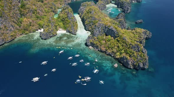 Thumbnail for Aerial High Attitude View of Rugged Towering Miniloc Island. El-Nido, Palawan. Philippines. Tourist