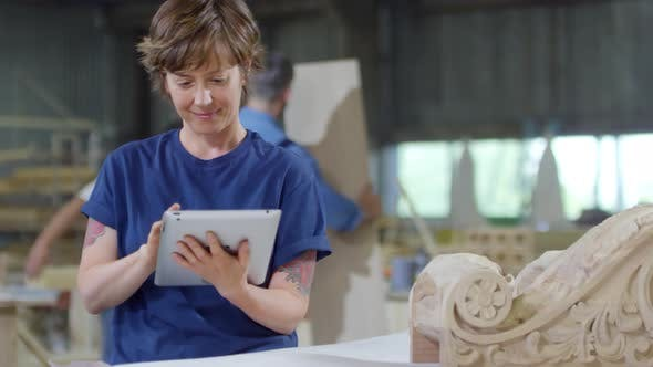 Thumbnail for Woman Using Tablet in Carpentry Shop