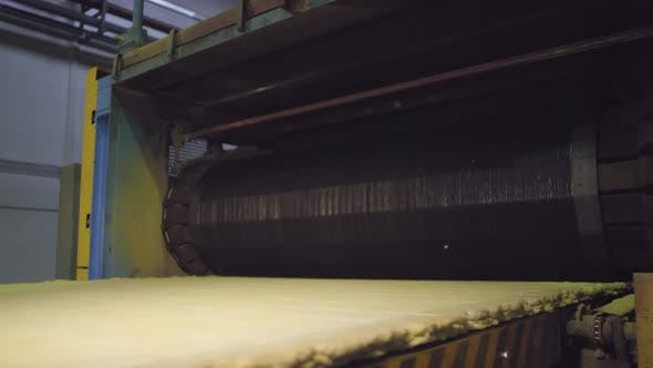 Thumbnail for Flattened Raw Mineral Wool Mass Coming out of Roller on Production Line