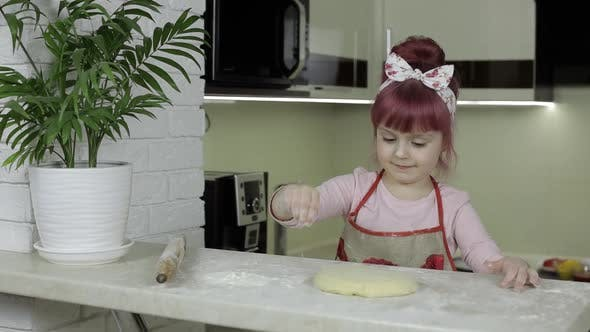 Thumbnail for Cooking Pizza. Little Child in Apron Sprinkle the Dough with Flour in Kitchen