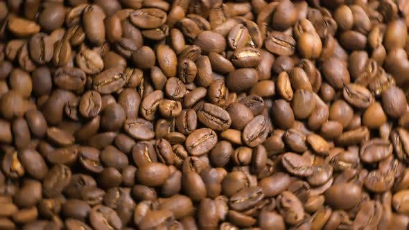 Thumbnail for Freshly Roasted Coffee Beans Rotate in Slow Motion Top View