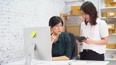 Asian Businesswomen Using Tablet in Office
