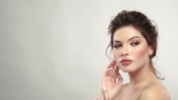 Young Woman with Fresh Clean Face Posing