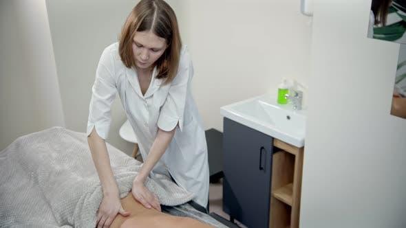 Thumbnail for Massage - Woman Massage Therapist Is Conducting a Back Massage