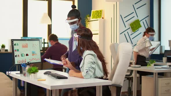 Thumbnail for Businesswoman with Protective Mask Discussing with African Colleague