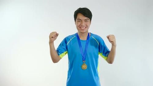 Asian Man Happy With Gold Medal