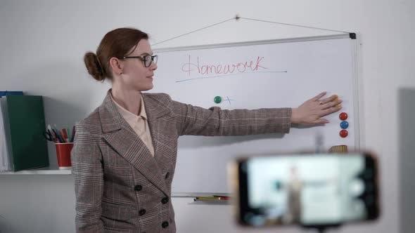 Online Teaching, Modern Female Teacher Tells Homework To Students Using Video Calling on Smartphone