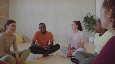Diverse Dancers Speaking in Studio