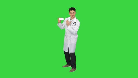 Thumbnail for Young Doctor Presenting New Pills and Dancing on a Green Screen, Chroma Key