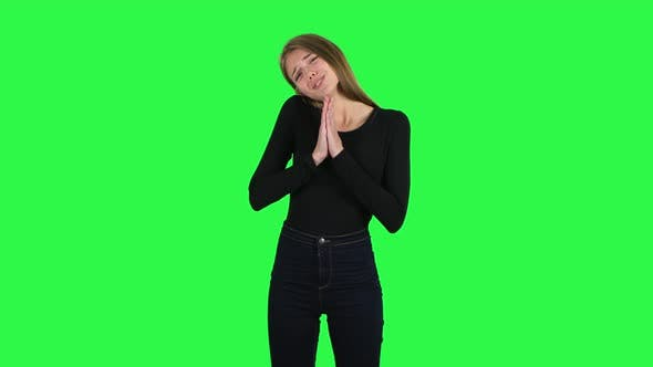 Cover Image for Young Woman Keeps Palm Together and Asks for Something . Green Screen