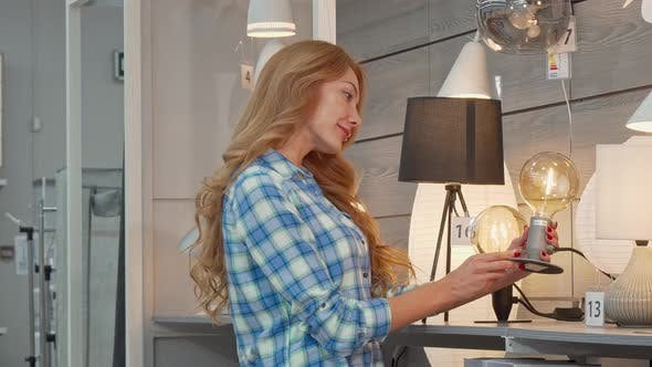Thumbnail for Beautiful Woman Shopping for Lighting for Her Apartment at Furniture Store