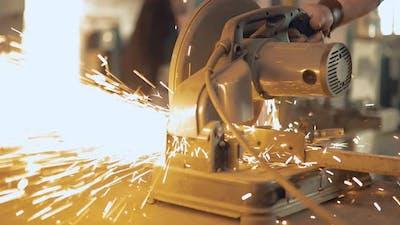 Man Cuts Metal with Tools Bulgarian