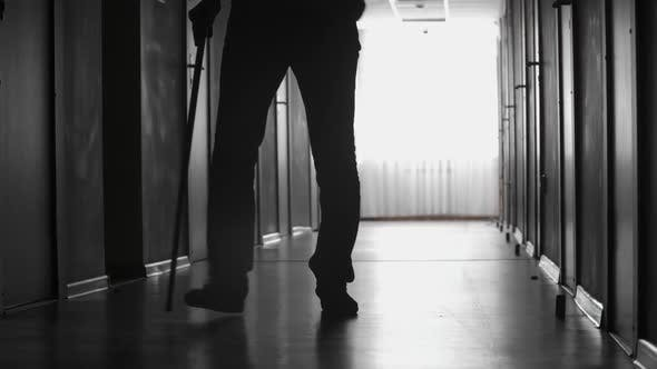 Cover Image for Man with Limp Walking along Corridor