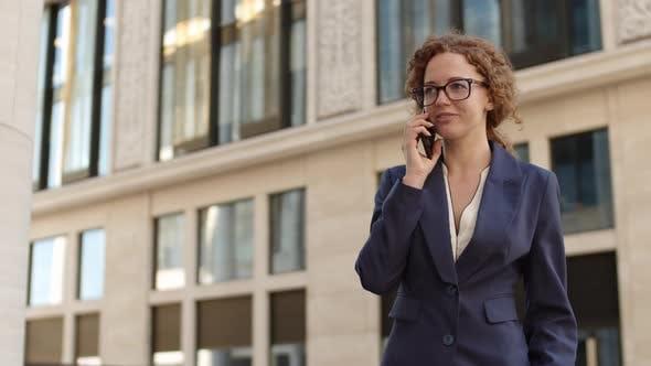 Pretty Businesswoman Having Telephone Conversation