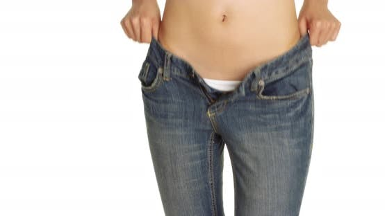 Thumbnail for Attractive woman putting on a pair of jeans