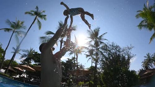A Loving Single Dad Playfully Throws His Daughter Up in the Air