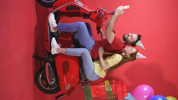Happy Caucasian Couple, Celebrating a Birthday on a Motorcycle, Scooter, Cheerful Man and Woman with