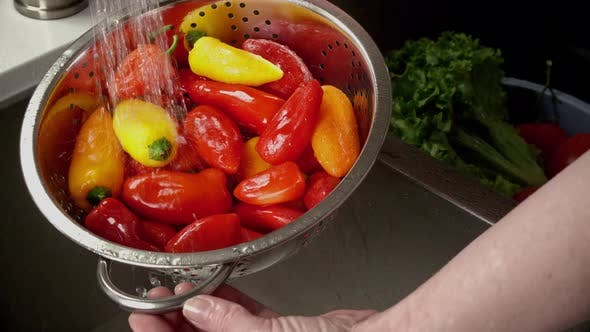 Thumbnail for Close Up Of Peppers Being Washed